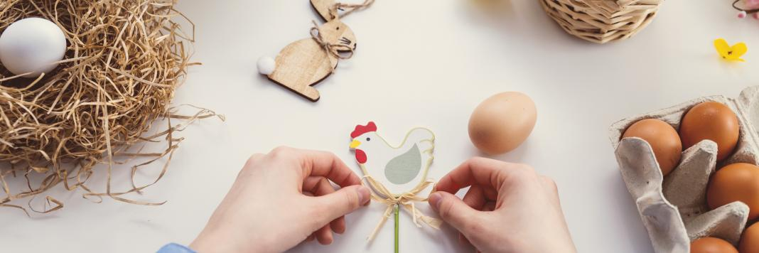 person tying knot on chicken decor 1040161